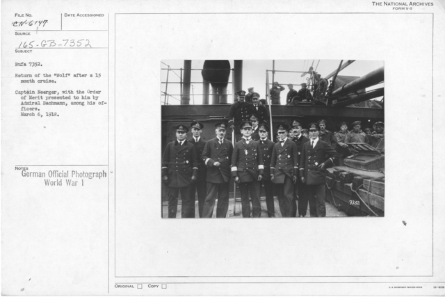"""Return of the """"wolf"""" after a 15 month cruise. Captin Neerger, with the order of Merit presented to him by admiral Bachmann, among his officers. March 6, 1918"""