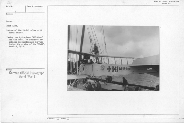 """Return of the """"wolf"""" after a 15 month cruise. Taking the hydroplane """"Wolfchen"""" off the deck. It rendered excellent reconnaissance service during the cruise of the """"Wolf"""". March 6, 1918"""