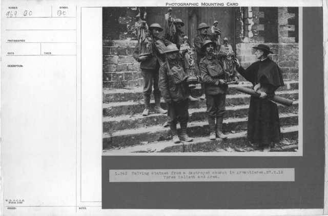 Salving statues from a destroyed church in Armentieres. Ypres Salient and Area. 2-27-1918