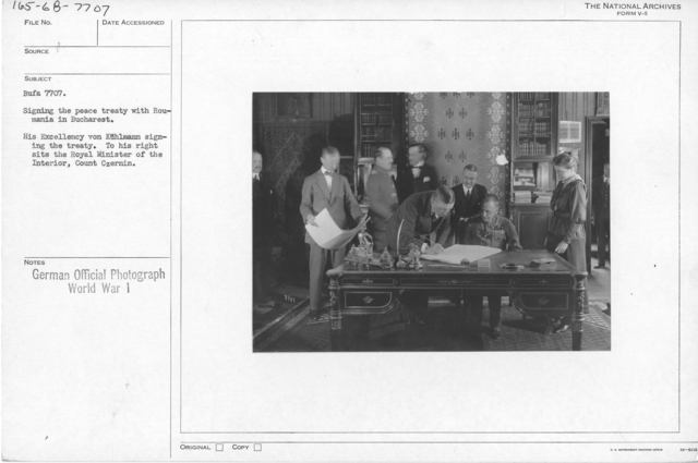 Signing the peace treaty with Roumania in Bucharest. His Excellency von Kulmann signing the treaty. To his right sits the Royal Minister of the Interior, Count Czernin