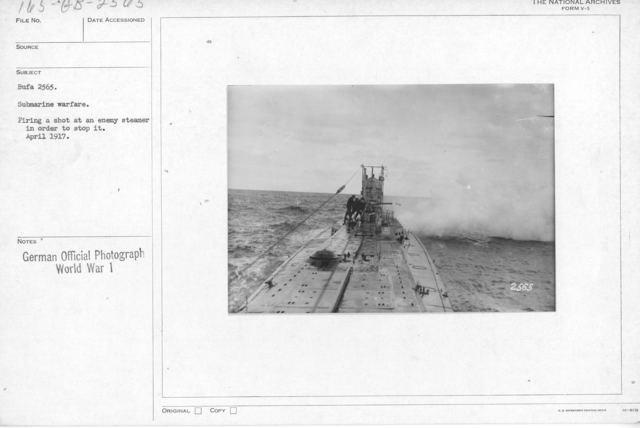 Submarine warfare. Firing a shot at an enemy steamer in order to stop it. April 1917