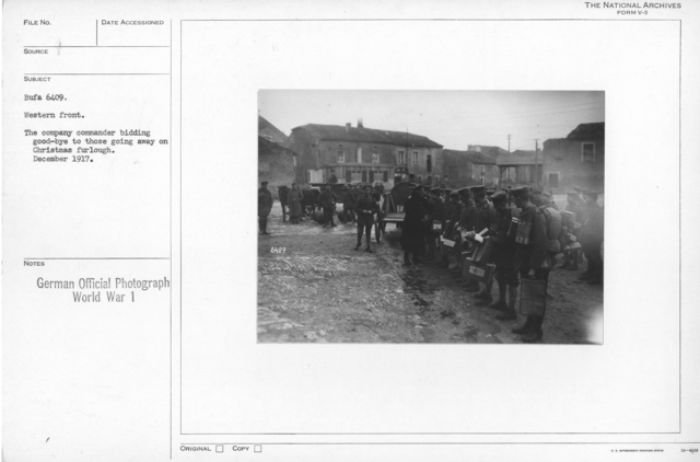 The company commander bidding goodbye to those going away on Christmas furlough. December 1917