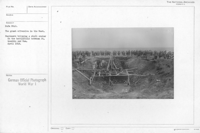 The great offensive in the West. Engineers bridging a shell crater on the battlefield between St. Quentin and Ham. April 1918