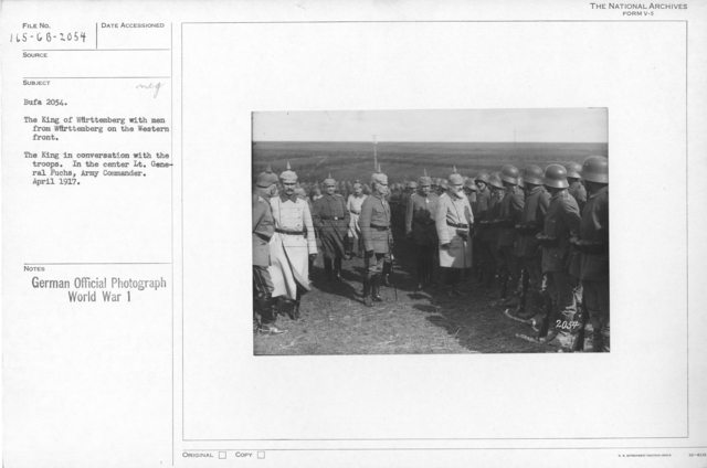 The king of Wuttemberg with men from wuttemberg on the western front. The king in conversation with the troops. In the center Lt. General Fuchs, Army commander. April 1917