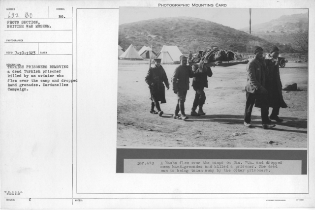 Turkish prisoners removing a dead Turkish prisoner killed by an aviator who flew over the camp and dropped hand grenades. Dardanelles Campaign