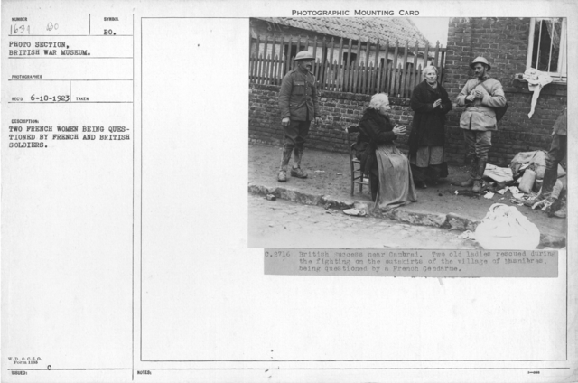 Two French women being questioned by French and British soldiers