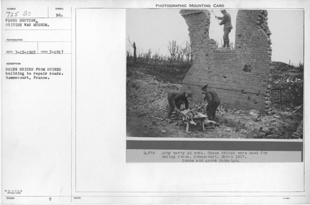 Using bricks from ruined building to repair roads. Gommecourt, France. March 1917