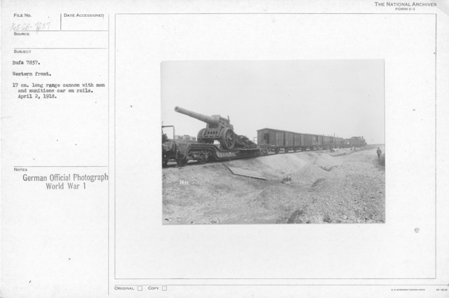 Western front. 17cm. Long range cannon with men and munitions car on rails. April 2, 1918