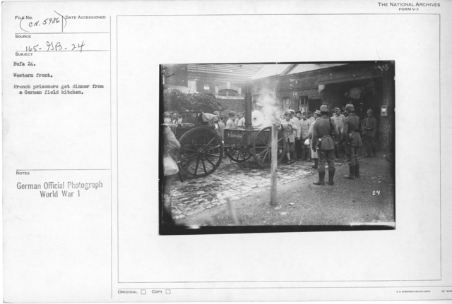 Western front. French prisoners get dinner from a German Field kitchen