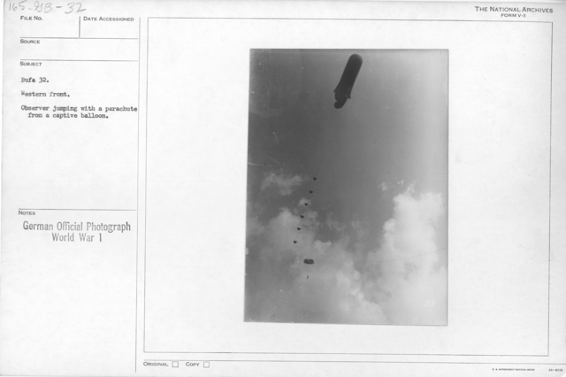 Western front. Observer jumping with a parachute from a captive balloon