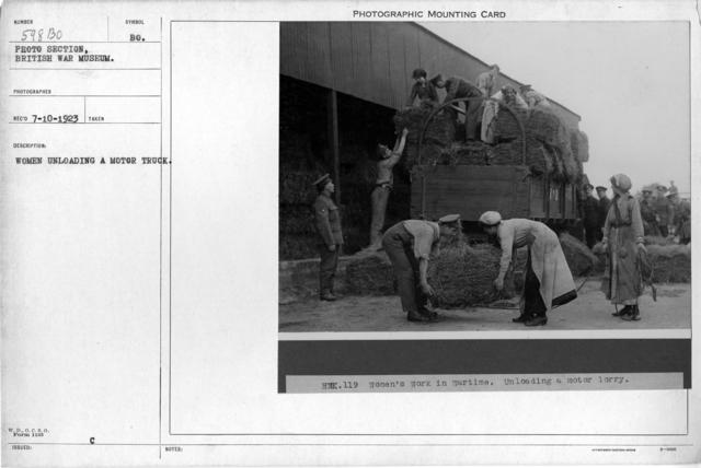 women unloading a motor truck