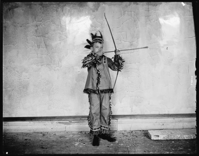 Photo of Boy Dressed as an Indian with Bow and Arrow