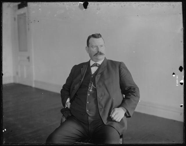 Photo of Man Seated in a Chair