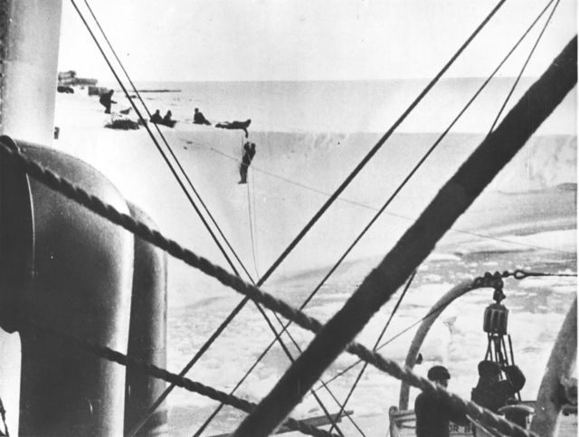 Photograph of Aerologist Henry T. Harrison of the Byrd Antarctic Expedition being Hauled to Safety by His Shipmates