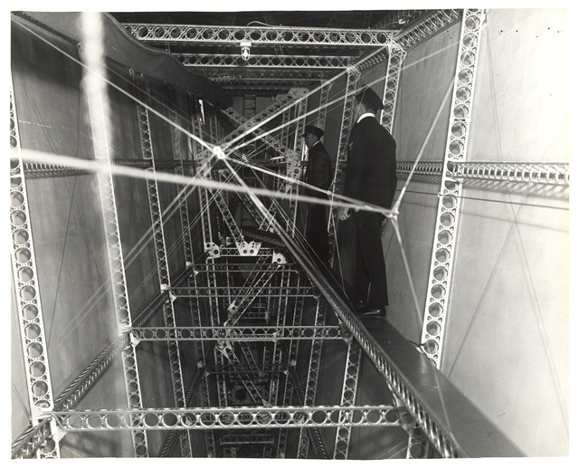 Photograph of Head-Chief Inspector of Structures Walking Through a Dirigible