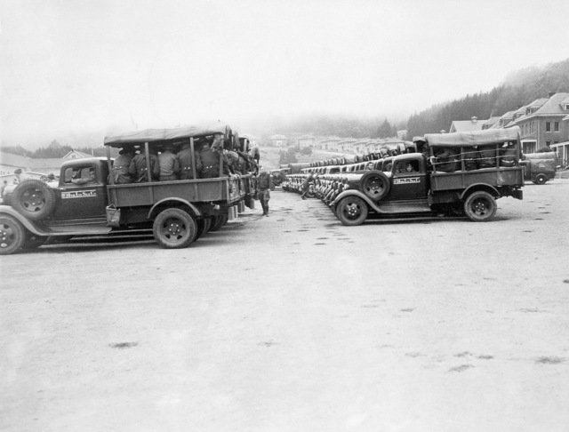 A fleet of Dodge 1-1/2 ton 4x4 Cargo Trucks from the 38th Infantry Service Company, 3rd Infantry Division (Marine Division), Camp Green, North Carolina, loaded with soldiers, gather on the parade ground at the Presidio of San Francisco