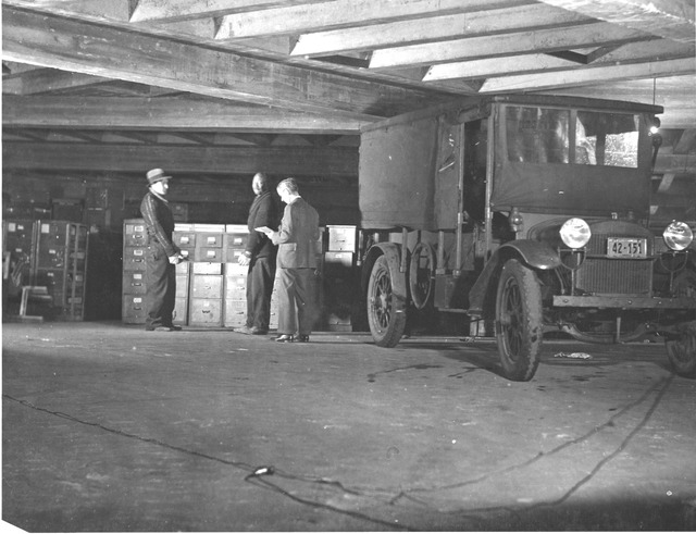 Photograph of Workers Moving U.S. Food Administration Records from White House Garage to the National Archives Building