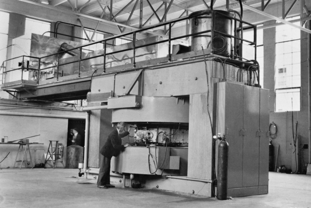 60-inch cyclotron with Donald Cooksey, taken in 1936. Morgue 1944-44 (P-1) [Photographer: Donald Cooksey]