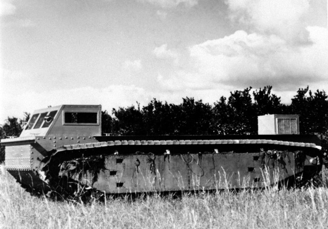 A right side view of the Roebling Alligator tractor as it sits in a field. The tractor is a Donald Roebling creation and is the vanguard for the present Marine LVTP-7 tracked landing vehicle