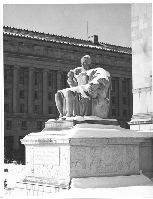 Photograph  of the Female Statue, Heritage of the Past, in the Snow near the Constitution Avenue Entrance to the National Archives Building