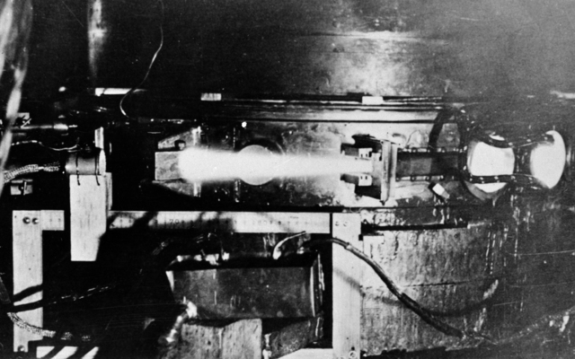 The first external cyclotron beam, obtained on March 26, 1936. The glow arises from the ionization of the air by the 5.8 MeV deuterons. Morgue 1944-35 (P-1) [Photographer: Donald Cooksey]