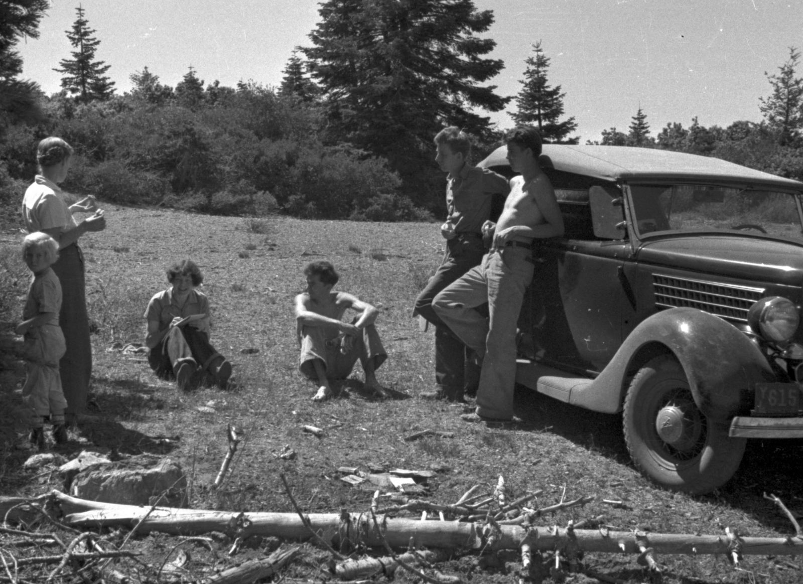Franz N.D. Kurie (right), Arthur H. Snell (second from right) and others on Pickets Peak in Trinity County. Cookesy caption: Ford I drove out for Franz in 1936 (May). Cooksey  27-28, June 1, 1936. [Photographer: Donald Cooksey]