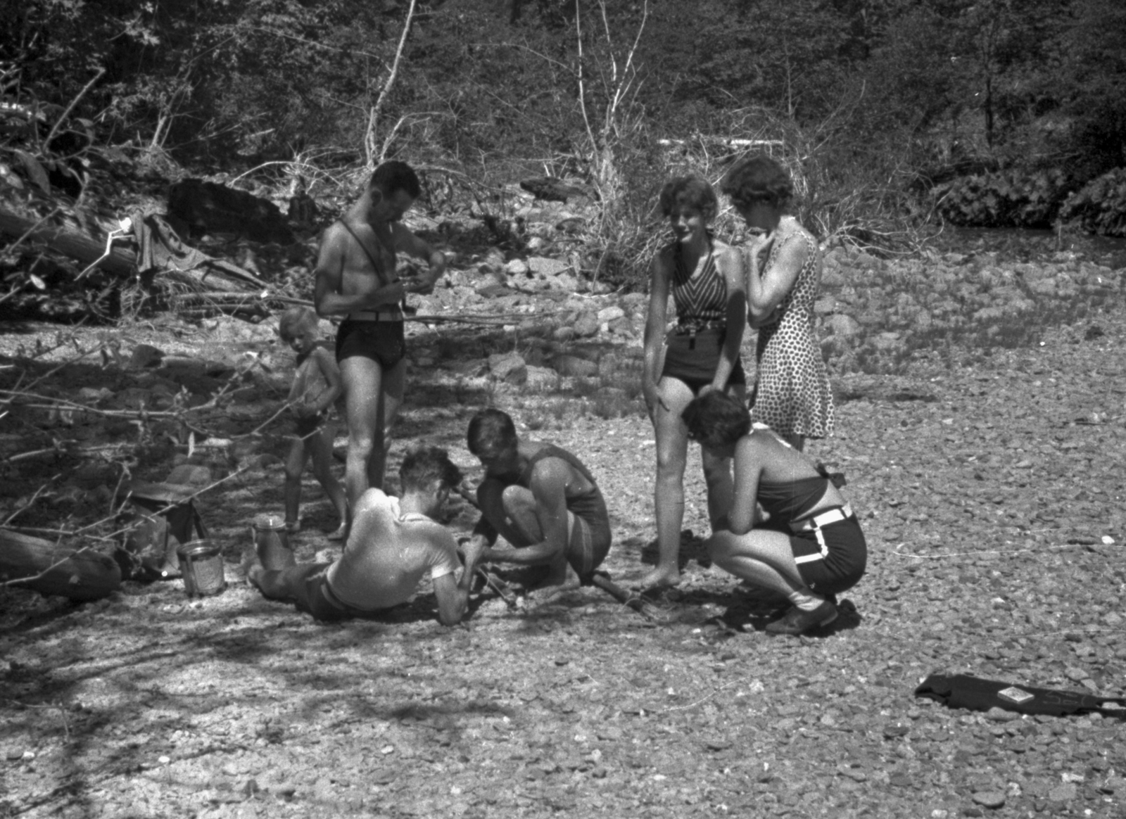 Franz N.D. Kurie (standing), Arthur H. Snell (laying down) and others at Trinity River. Cooksey  27-16, June 1, 1936. [Photographer: Donald Cooksey]