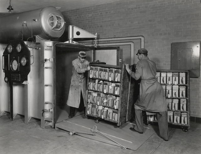 Photograph of Employees of the National Archives Fumigating Veterans Administration Records