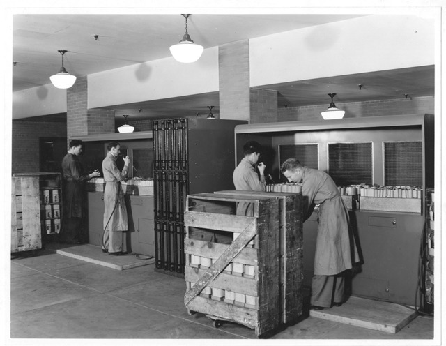 Photograph of Workers Dusting Veteran's Administration Records