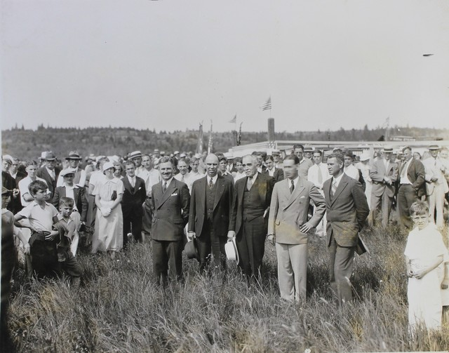 Men and Crowd in Field