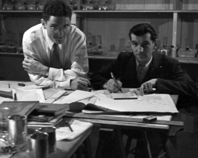 Lampi and Paul Aebersold at desk. Cooksey  17-9, September 25. 1936. [Photographer: Donald Cooksey]