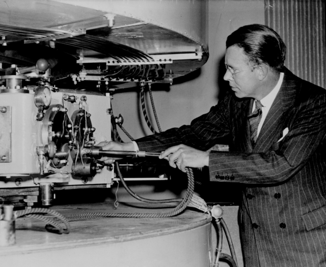 Ernest Orlando Lawrence at the 60-inch cyclotron, 1937. Morgue 1958-8 (P16) [Photographer: Donald Cooksey]