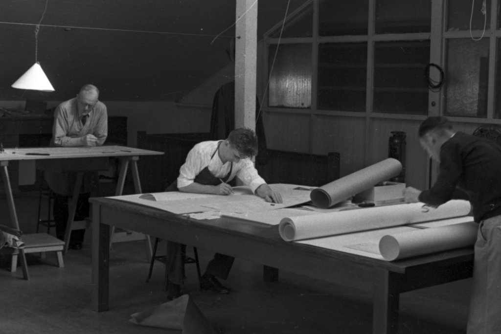 Bill Brobeck (right) working on drawings. Cooksey  22 - 9, January 1, 1938. [Photographer: Donald Cooksey]