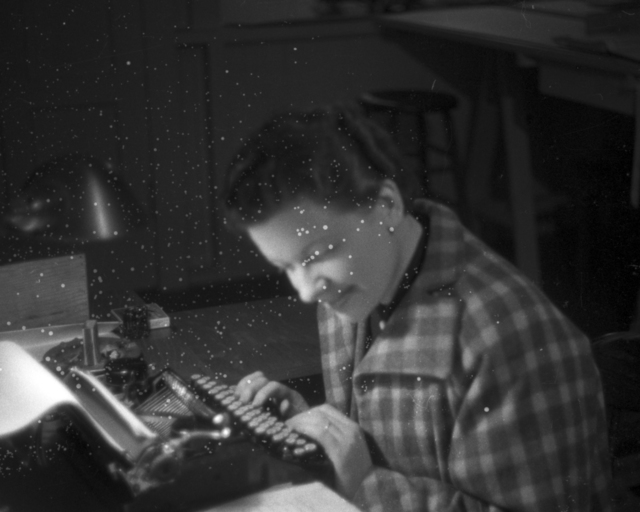 Dottie Kurie at typewriter. Damaged negative. Cooksey  23-21, January 30, 1938. [Photographer: Donald Cooksey]