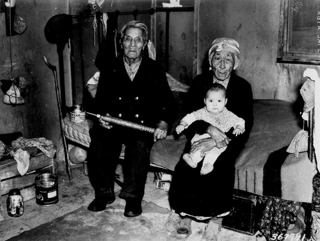 Photograph of Chief of the Chippewa Tribe Bob Mosmo with His Squaw and Their Granddaughter in Inger Indian Village