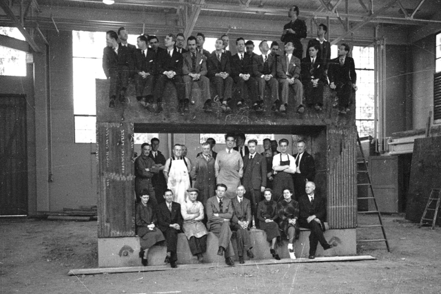 "Ernest O. Lawrence and workers sitting inside and on top of of 60"" cyclotron magnet yoke in August 1938.  Originally from film #8, page 2, frame #7. See also B&W negative Cooksey-789. [Photographer: Donald Cooksey]"