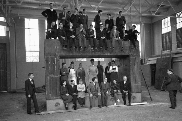 "Ernest O. Lawrence and workers sitting inside and on top of of 60"" cyclotron magnet yoke in August 1938.  Originally from film #8, page 2, frame #6. See also B&W negative Cooksey-789. [Photographer: Donald Cooksey]"