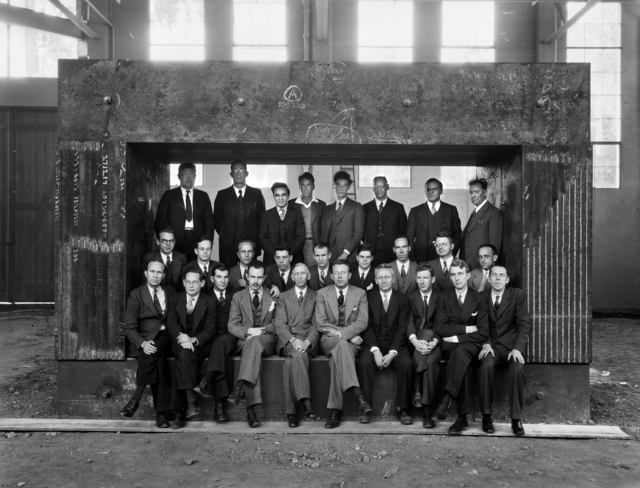 Staff of the Radiation Laboratory and those of the Physics Department closely associated with the work on the 60-inch cyclotron., taken September, 1938. First row (left to right): J.H. Lawrence, R. Serber, P.C. Aebersold, F.N.D. Kurie, R.T. Birge, E.O. Lawrence, D. Cooksey, A.H. Snell, L.W. Alverez, P. Abelson. Middle row: J.G. Backus, A. Langsdorf, J.G. Hamilton, S.J. Simmons, E.M. McMillan, R.R.Wilson, W.M. Brobeck, E.M. Lyman, J.J. Livingood. Back row: D.H. Slone, R. Corog, M.D. Kamen, W.B. Mann, J.R. Oppenheimer, E.S. Viez, D.C. Kalbfell, W.W. Silisbury. [Photographer: Donald Cooksey]