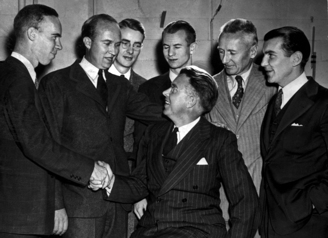 Ernest Orlando Lawrence receiving congratulation for winning the Nobel Prize in 1939. From left: Bill Brobeck, John Lawrence, Luis Alvarez, Edwin McMillan, Donald Cooksey, and Paul Aebersold. XBB688-4790 [Photographer: Donald Cooksey]