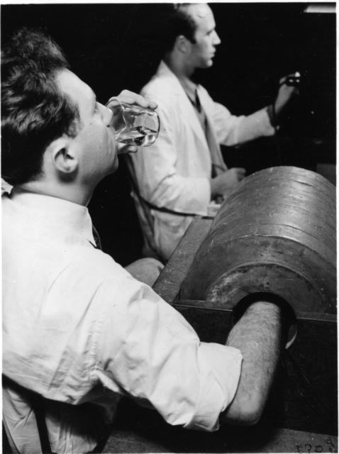 Joseph Hamilton (rear) and Robert Marshak (left)drinking radiosodium, January 1939. XBB6808-04762 [Photographer: Donald Cooksey]