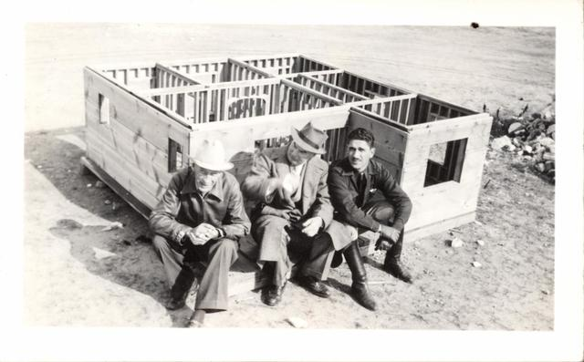 Messrs. Arthur, Parkey, and Shoor with Model House