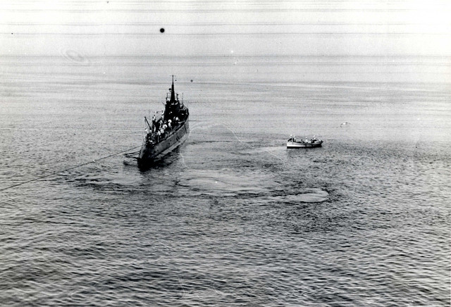 Submarine Sculpin Lying off the Port Beam of the Salvage Ship Falcon, Assisting with Pumping Operations through a Hose Line