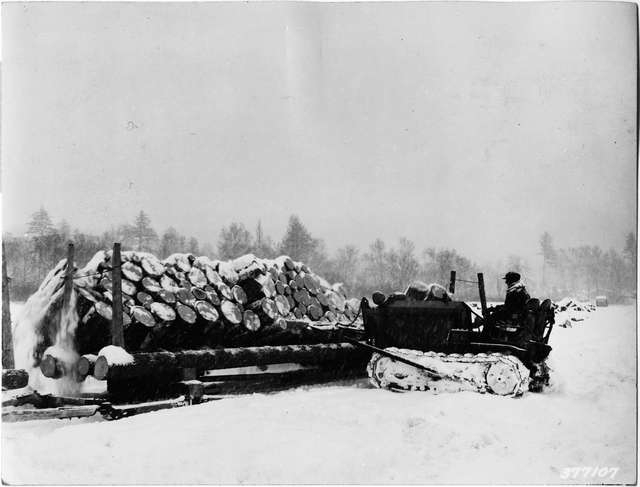 Brown Company Worker Using Tractor to Push Pulp Logs from Sled onto the Ice in Magalloway Township, Maine
