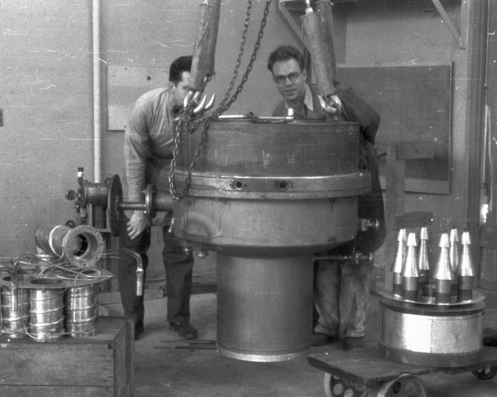 William Farley  and John Backus behind 60-inch cyclotron vacuum chamber. Cooksey  14-30,  Feburary 15, 1939. [Photographer: Donald Cooksey]