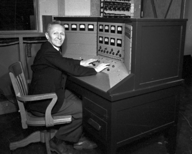 Donald Cooksey  at control panel at 60-inch cyclotron. Cooksey  15-27,  March 1, 1939. [Photographer: Donald Cooksey]
