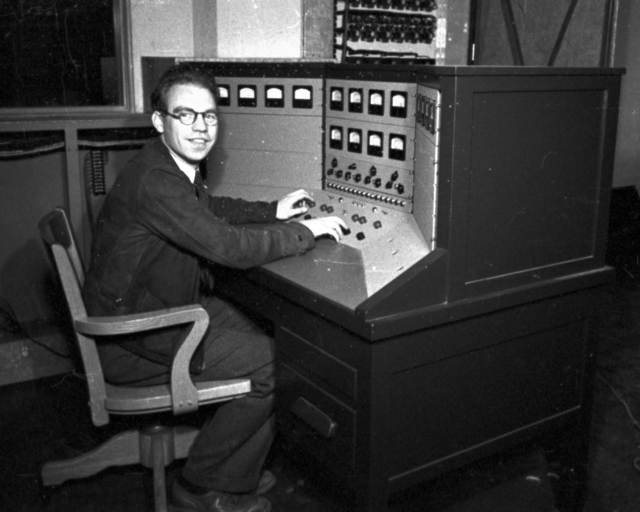 John Backus  at control panel at60-inch cyclotron. Cooksey  15-28,  March 1, 1939. [Photographer: Donald Cooksey]