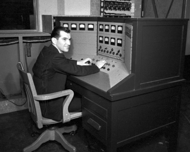 Paul Aebersold at control panel at 60-inch cyclotron. Cooksey  15-23,  March 1, 1939. [Photographer: Donald Cooksey]
