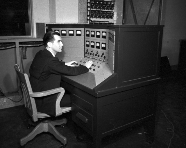 Paul Aebersold at control panel at 60-inch cyclotron. Cooksey  15-25,  March 1, 1939. [Photographer: Donald Cooksey]