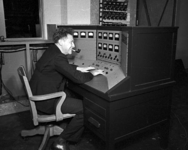 Robert Marshak at control panel at 60-inch cyclotron. Cooksey  15-30,  March 1, 1939. [Photographer: Donald Cooksey]