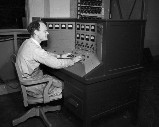 Robert Thornton at control panel at 60-inch cyclotron. Cooksey  15-29,  March 1, 1939. [Photographer: Donald Cooksey]